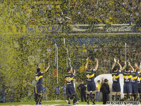 Argentina's Boca Juniors salute their fans before a Copa Libertadores match against Uruguay's Defensor Sporting.