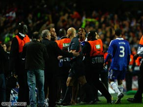 Didier Drogba confronts referee Tom Henning Ovrebo after Chelsea's semifinal exit.