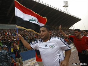 Iraq's Ala Abdel Zahra is overcome with emotion after scoring in the 4-0 victory over Palestine.