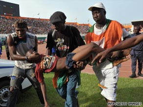 A young fan is carried away following the crush that saw 22 supporters lose their lives in Abidjan in March.