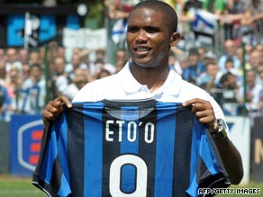 Samuel Eto'o parades his new Inter Milan jersey after completing his move from Barcelona.
