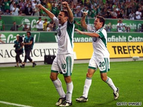 Zvjezdan Misimovic (left) celebrates his goal with Sascha Riether as Wolfsburg defeated Stuttgart 2-0.