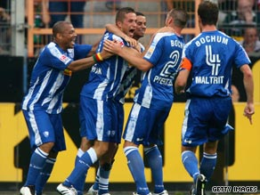 Stanislav Sestak (second left) celebrates his goal as Bochum fought back to draw with Moenchengladbach.