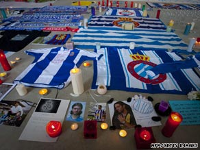 An Espanyol supporter cannot hide his grief following the tragic death of captain Daniel Jarque.