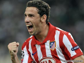 Maxi Rodriguez celebrates scoring the opening goal in Atletico Madrid's 3-2 win in Greece.