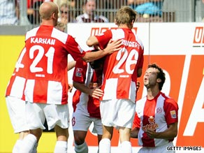 Mainz celebrate their opening goal in their surprise 2-1 victory over Bayern Munich on Saturday.