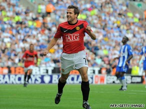 Michael Owen celebrates his first Manchester United goal as the English champions thumped Wigan 5-0.