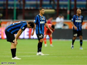 A dejected Inter team contemplate their dropped points in the San Siro.