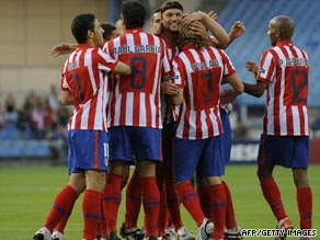 Atletico Madrid celebrate their opening goal as they reachyed the group stage of the Champions League.