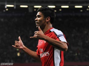 Eduardo celebrates his opening penalty strike for Arsenal at the Emirates.