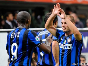 New boys Samuel Eto'o (left) and Wesley Sneijder celebrate Inter's impressive victory over Milan.