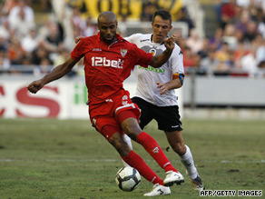 Fredi Kanoute holds off Valencia defender Carlos Marchena during Sevilla's 2-0 defeat.