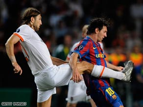 Chygrynskiy challenges now teammate Lionel Messi during the European Super Cup.