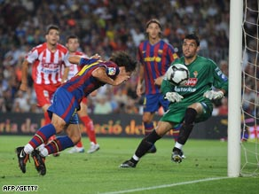 Bojan heads home Barcelona's opener in the Camp Nou.