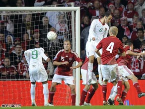 Liedson (no 9) heads home Portugal's late equalizer in Copenhagen against the Danes.