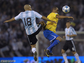 Argentina's midfielder Juan Veron (L) competes for the ball with Brazil's forward Luis Fabiano.