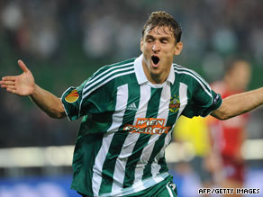 Nikica Jelavic celebrates after putting Rapid Vienna 2-0 up against Bundesliga leaders Hamburg.