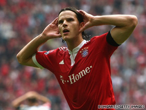 Belgian defender Daniel Van Buyten celebrates his winning goal for Bayern Munich.