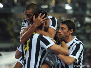 Juventus celebrate Iaquinta's early opener in Turin.