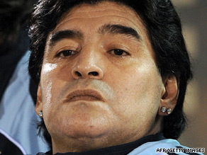 Diego Maradona sports expensive-looking earrings during a recent football match.