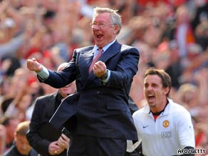 Ferguson and substitute Gary Neville celebrate Owen's late winner.