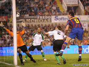 Zlatan Ibrahimovic rises to head home Barcelona's opening goal against Racing Santander.