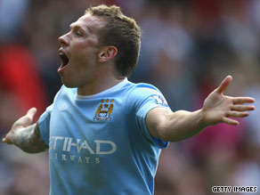 Craig Bellamy scored twice as Manchester City suffered a heartbreaking 4-3 defeat at Old Trafford.
