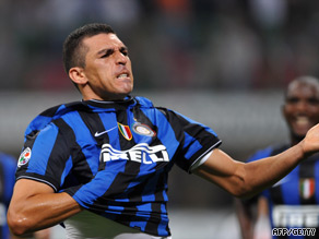 Brazilian ace Lucio celebrates his third goal for Inter in the San Siro.