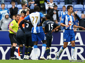 Goalkeeper Petr Cech is about to be sent off by referee Phil Dowd in the key moment at Wigan.