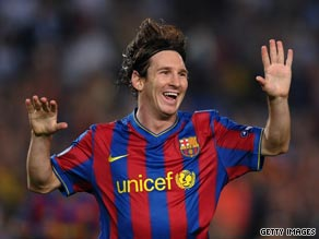 Lionel Messi celebrates his goal as holder Barcelona beat Dynamo Kiev 2-0 at the Nou Camp.