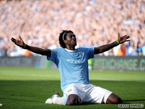 Adebayor celebrates in front of the Arsenal fans during Manchester City's 4-2 victory last month.