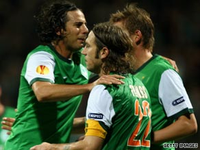 Torsten Frings (22) is congratulated by team-mates after scoring Werder's third goal against Bilbao.