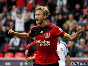 Bayer midfielder Simon Rolfes celebrates his penalty strike in the easy win.