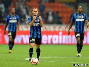 Sneijder celebrates his late winner in the San Siro for Inter.
