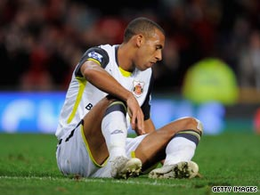 A dejected Anton Ferdinand reflects on his late own goal at Old Trafford.