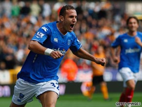 Yebda celebrates his 19th minute goal for Pompey which proved the winner at Molineux.