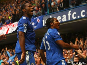 Drogba (left) and Malouda celebrate the second goal at Stamford Bridge.