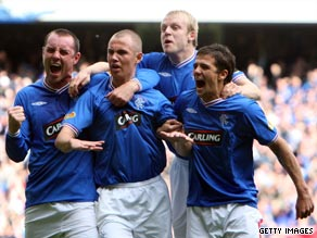 Kenny Miller (second left) celebrates his second goal as Rangers won the first 'Old Firm derby' of the season.