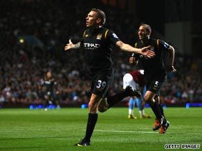 Craig Bellamy celebrates his equalizing goal as Manchester City earned a 1-1 draw at Aston Villa.