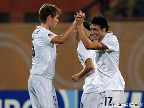 Mattia Mustacchio (right) celebrates his opening goal in Italy's 3-1 victory over Spain in Cairo.