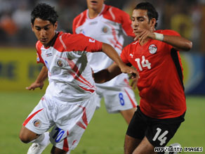 Costa Rica's Diego Estrada, left, battles with Hosam Hassan of Egypt in Cairo on Tuesday.