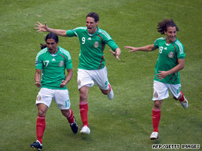Francisco Palencia (left) celebrates his goal as Mexico secured their place in the finals.