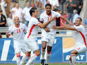 Tunisia's players celebrate Jomaa's first minute goal in the 1-0 win over Kenya.