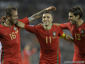 Simao Sabrosa (center) celebrates his goal as Portugal securd their place in the World Cup playoffs.