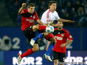 Bayer Leverkusen's Daniel Schwaab, left, battles with Tunay Torun of Hamburg during Saturday's stalemate.