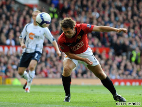Michael Owen's deflected header put Manchester United on the road to a hard-fought victory.