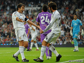 Raul, left, celebrates his first goal against Valladolid with Raul teammate Esteban Granero.