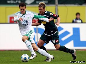 Christian Gentner (left) scored Wolfsburg's second goal in their win over Moenchengladbach.