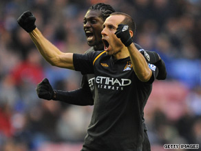 Martin Petrov celebrates his equalizing goal as Manchester City drew 1-1 at Wigan on Sunday.