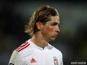 A dejected Torres faces up to Liverpool's defeat to Fiorentina in Florence.